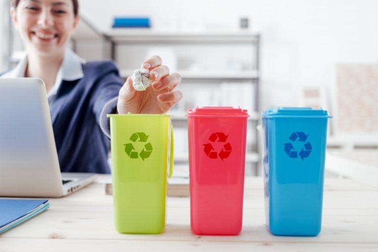 woman throwing her trash in organized bins