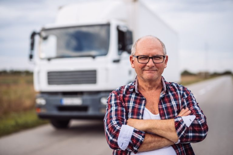 Man posing in front of his truck