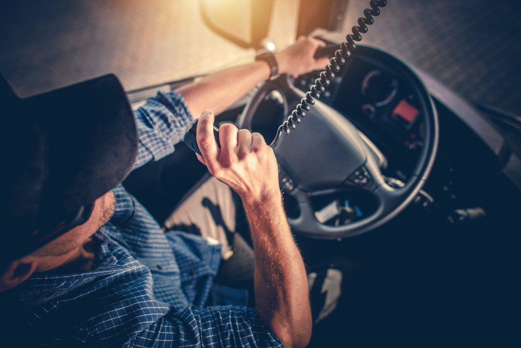 truck driver using the radio to communicate