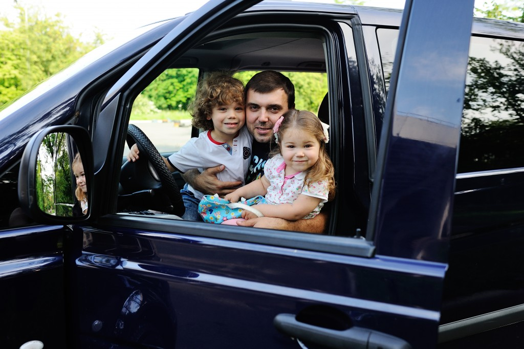 Father with his 2 daughters inside the car