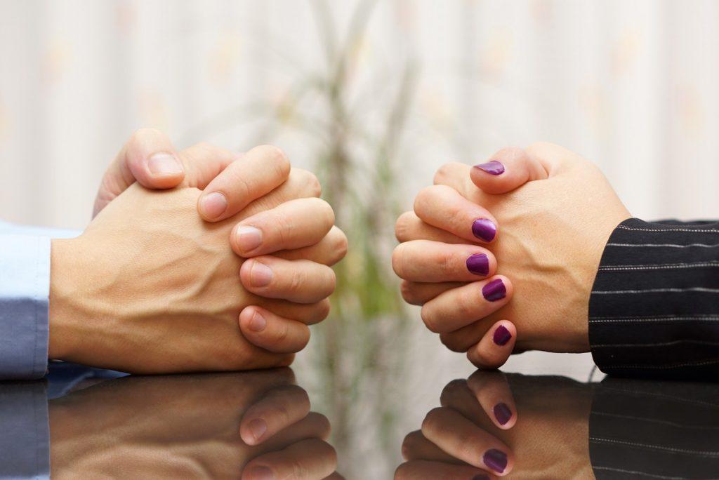 hands of divorced couple