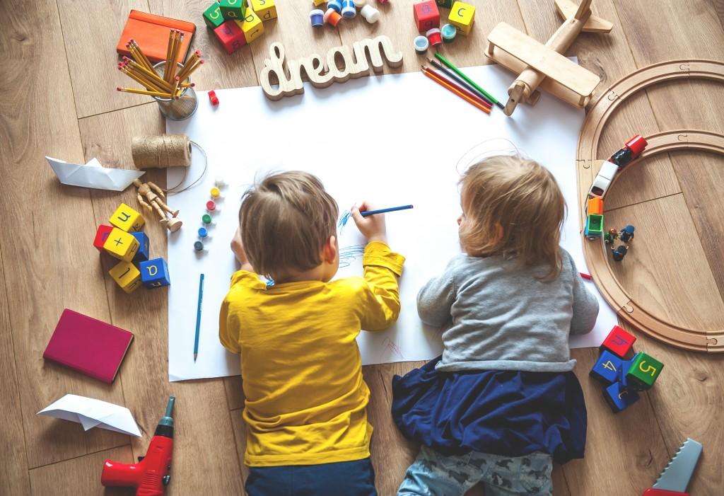 kids on the floor writing