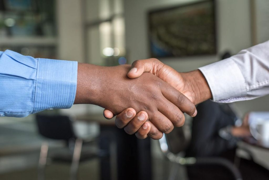 man shaking his recruiters hands